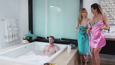 Two hot masseuses are in the mood for some FFM threeway fuck