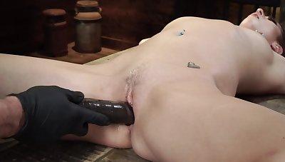Naked slavegirl is fingered and dildo fucked