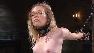 Nerdy chick is happy to try some bondage for the first grow older